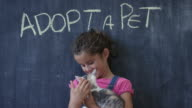 Young Girl Pets Newly Adopted Kitten video
