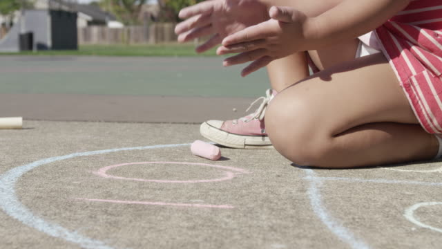 Young girl playing Hopscotch at park video