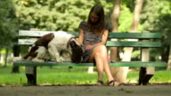 Young Girl Playing In Park With Funny Dog video
