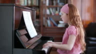 Young girl playing the piano video