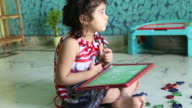 Young girl playing with alphabet letters video