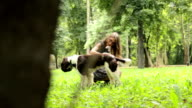 Young girl playing with dog video
