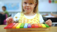 Young girl playing xylophone at school video