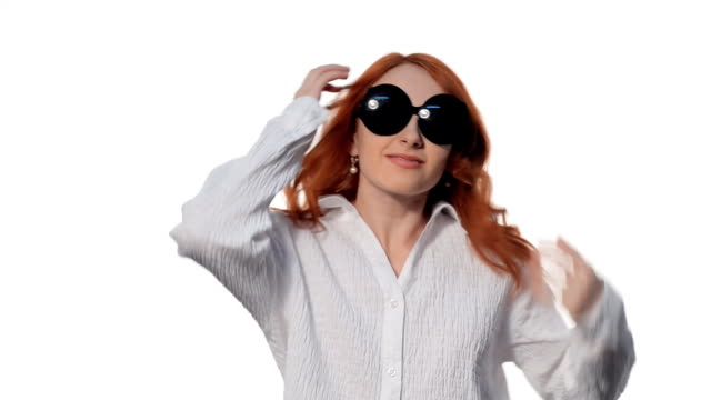 Young girl posing in funny glasses video