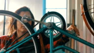 Young girl repairing bicycle video