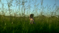 Young Girl Running Through Grass Left video