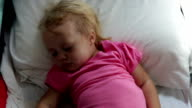 Young Girl Sleeping In Bed As It Becomes Dark video