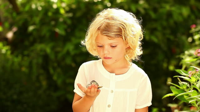 Young girl surrounded by butterfly video