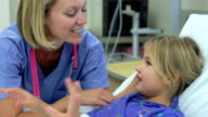 Young Girl Talking To Female Nurse In Intensive Care Unit video