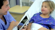 Young Girl Talking To Male Nurse In Intensive Care Unit video