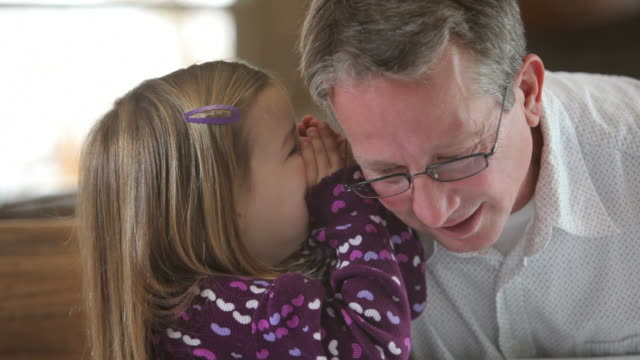 Young girl tells Grandfather a secret video