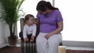 Young girl touching mothers pregnant belly video