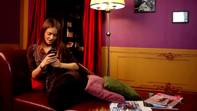 Young girl typing message, flirting in social network, lounge video