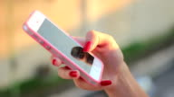 Young girl using smartphone to send short message video