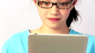 Young girl using tablet device close- up video