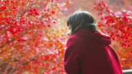 Young girl viewing autumn leaves in Japan video