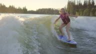 Young girl wake surfing behind boat video