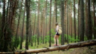 Young girl with a backpack in the woods video