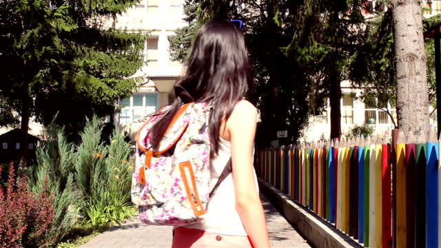 Young girl with backpack is going back to school video