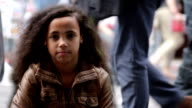 Young girl with crowd passing by video