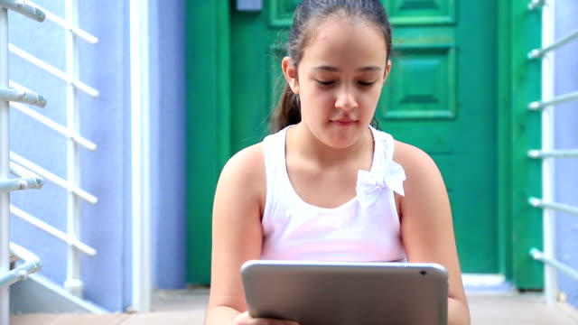 Young girl with digital tablet video