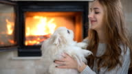Young Girl with her dog playing at the home. video