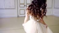 Young girl with long hair dances in long evening dress video
