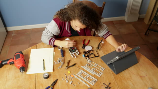 Young Girl Works on Robotics Project video