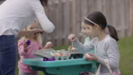 Young girls dying and coloring Easter eggs video