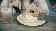 Young girls eating sandwich. video