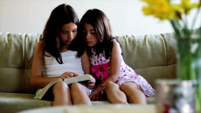 Young Girls Looking Through a Book video