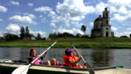 Young girls paddling canoe in river video
