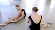 Young girls prepare for ballet lesson in dancing class video