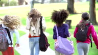 Young Girls Running In Slow Motion Away From Camera In Park video