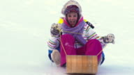 Young girls Tobogganing in Super Slow motion video