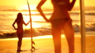 Young Girls with Surfboard at Sunrise video