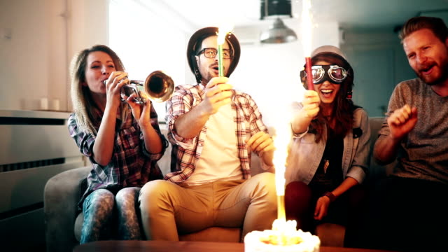 Young group of happy friends celebrating birthday video