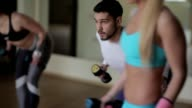 Young guy doing exercises with dumbbells video