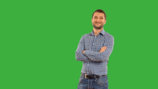 Young guy  on a green background with alpha channel video