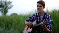 Young Guy Playing Guitar video