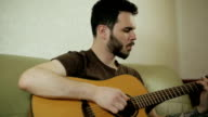A young guy playing the guitar. video