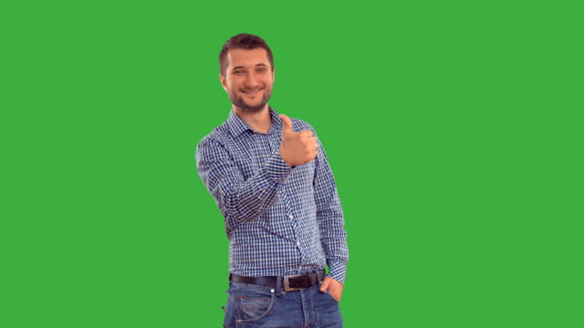 Young guy showing ban on a green background video