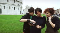 Young guys with a digital guide of Piazza dei Miracoli video