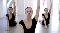 Young gymnasts do exercise for development stretching of their bodies video