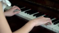 Young hands playing on the piano keyboard video