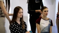 Young handsome girls prepare for photoshoot in studio video