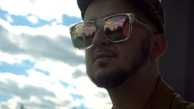 young handsome man with beard in mirror sunglasses video