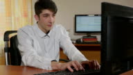 Young handsome programmer finishing and high-fiving with a third hand video
