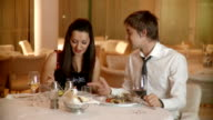 Young happy couple at restaurant video