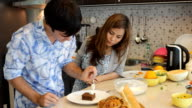 Young happy couple cooking together video